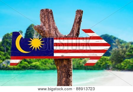 Malaysia Flag wooden sign with beach background
