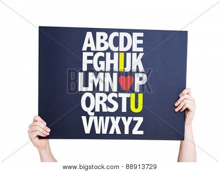 Alphabet with a Romantic message (I Love You) card isolated on white