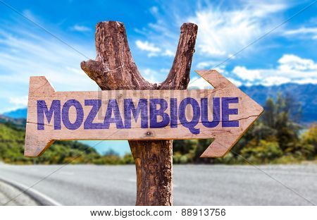 Mozambique wooden sign with road background