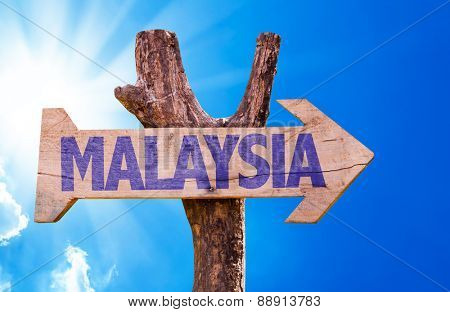 Malaysia wooden sign with sky background