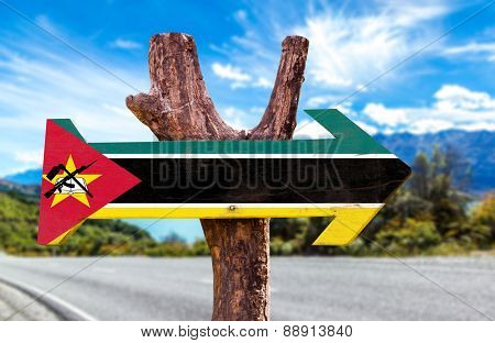 Mozambique Flag wooden sign with road background