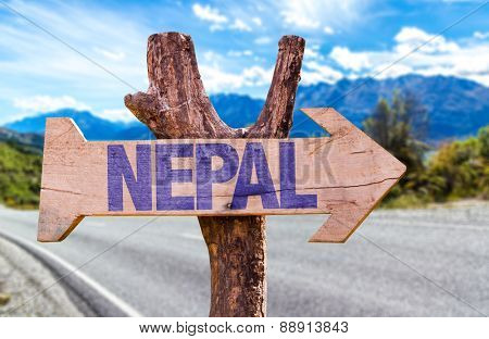 Nepal wooden sign with road background