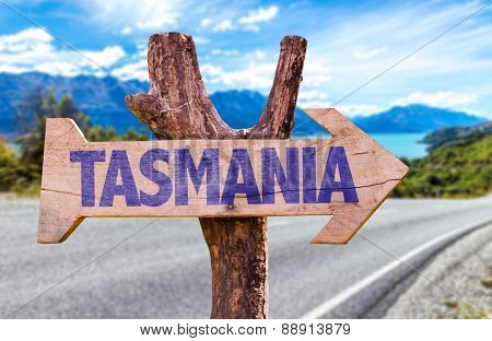 Tasmania wooden sign with road background