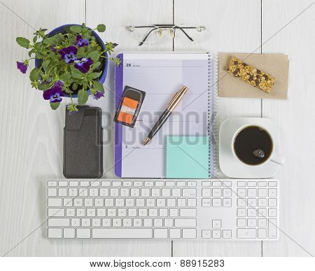 Office Desktop With Many Objects On Wood