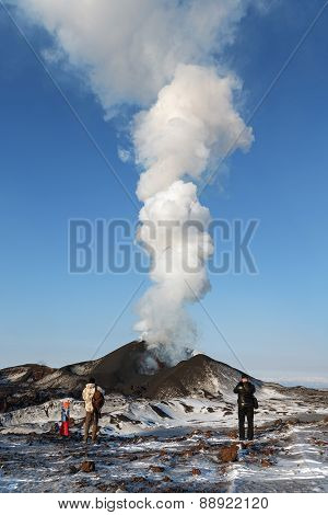 Tourists Watching The Eruption Of A Tolbachik Volcano, Ejecting Lava, Steam, Gas And Ash. Kamchatka