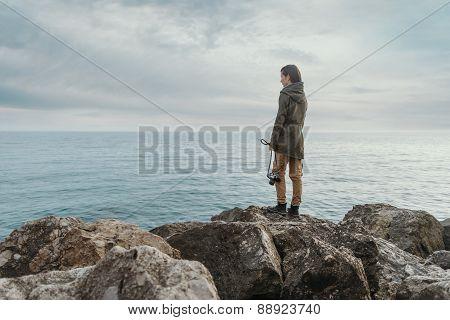 Traveler Girl Standing On Stone Coast