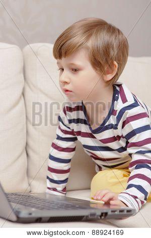 Boy uses computer
