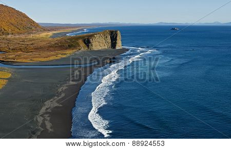 Pacific Coast With Black Volcanic Sand On The Beach. Kamchatka, Russia