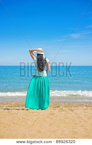 Brunette with long hair turned away