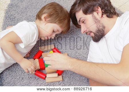 Father and son play together