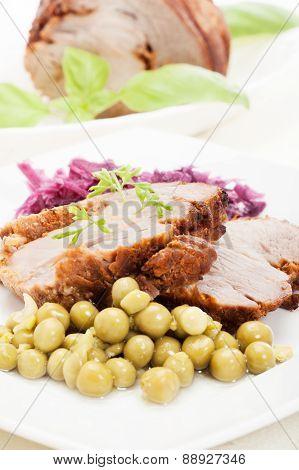 Roast pork with sauce on plate
