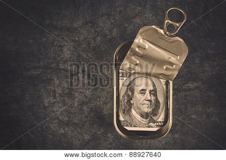Hundred Dollar Bill In Open Empty Sardine Fish Tin Can