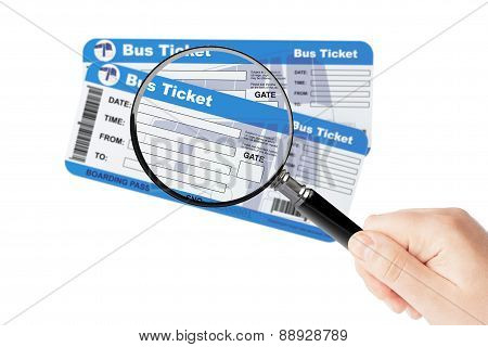 Bus Boarding Pass Tickets With Magnifier Glass In Hand