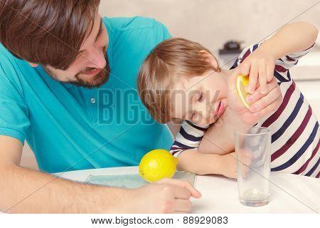 Father and son make lemonade