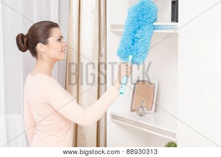 Beautiful woman working with cleaning sweep