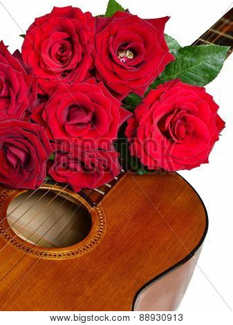Bouquet Of Red Roses On Top Of Classical Guitar Isolated