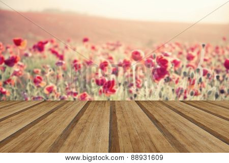 Stunning Poppy Field Landscape Under Summer Sunset Sky With Cross Processed Retro Style Effect With