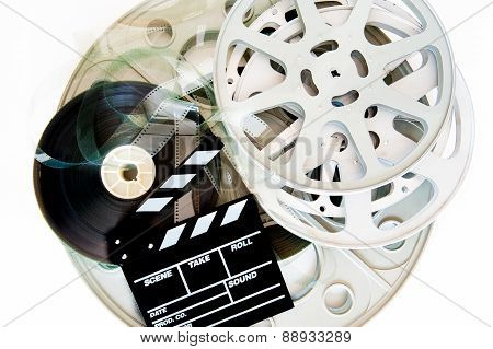 Stack Of Movie Film Reels With Clapper