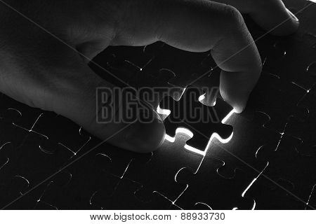 Black Puzzle On A White Background