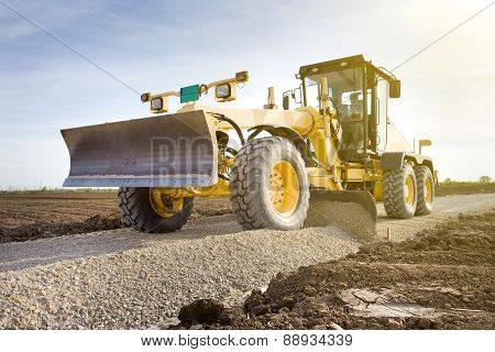Grader Working On Gravel Leveling
