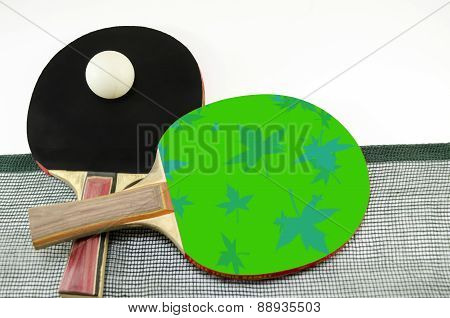 Two Table Tennis Rackets And A Net Isolated