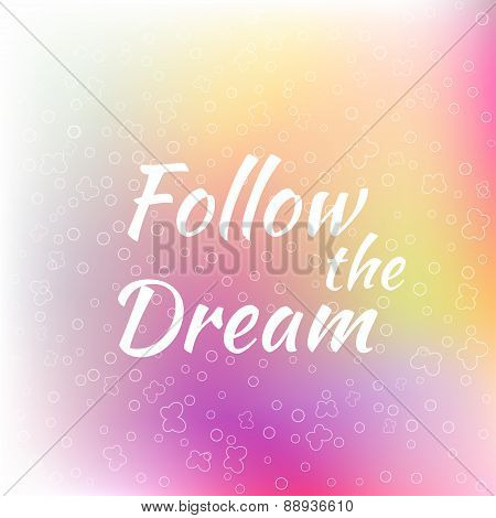 Follow the Dream lettering on unfocused colorful background.