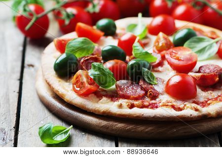 Italian Hot Pizza With Salami, Olive And Tomato