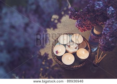 Small White Candles In A Basket, Massage Oil And Essence