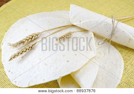 Bunch Of Tortillas And A Stick Of Wheat