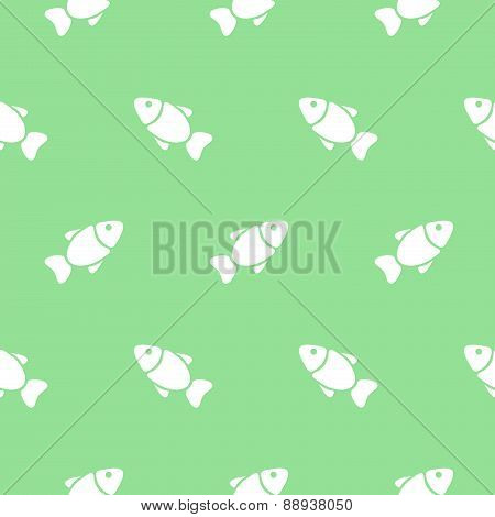 Seamless pattern with fishes on green. Vector illustration.