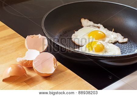 Fried Eggs In A Pan And Egg Shells
