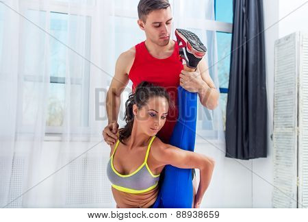 Active sportive woman stretching doing exercises aerobics or warming up with gymnastics for flexibil