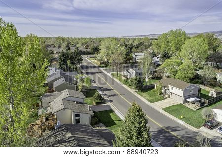 FORT COLLINS, CO, USA - APRIL 25, 2015: Aerial view of a residential street in Fort Collins with 30 years old houses, early spring with green trees and lawns