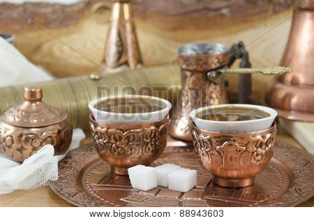 Copper Plates And Cups Filled With Coffee