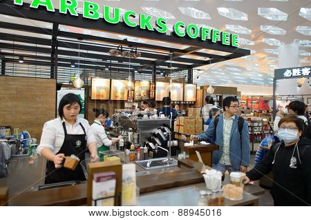 SHENZHEN, CHINA - FEBRUARY 16, 2015: Starbucks Cafe interior. Starbucks Corporation is an American global coffee company and coffeehouse chain based in Seattle, Washington