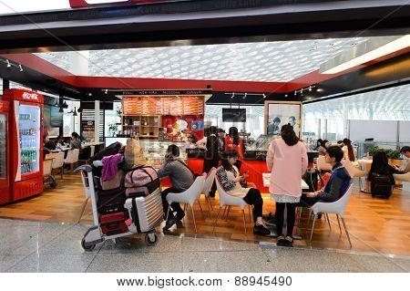 SHENZHEN, CHINA - FEBRUARY 16, 2015: Shenzhen Bao'an International Airport interior. Shenzhen Bao'an International Airport is located near Huangtian and Fuyong villages in Bao'an District, Shenzhen
