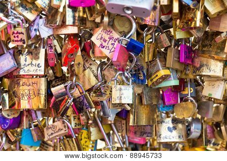 PARIS, FRANCE - CIRCA JAN 2015: Love Padlocks at Pont de l'Archevche in Paris. The thousands of locks of loving couples symbolize love forever.