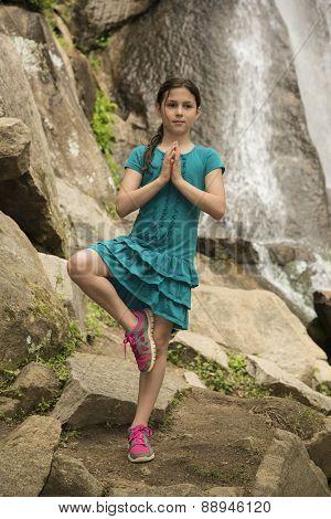 Yoga Tree Pose Girl under waterfalls