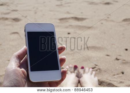 Using Smartphone On A Beach