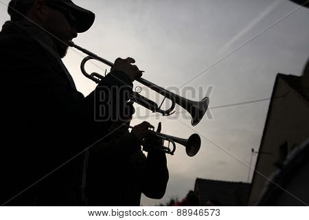 TURNOW, GERMANY - MARCH 12, 2011: Local brass band attends the Zampern Carnival in the Lusatian village of Turnow near Cottbus, Lower Lusatia, Brandenburg, Germany.