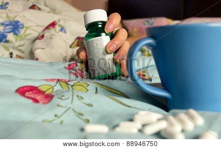 Hand With A Pill Bottle