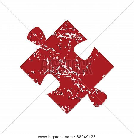 Red grunge puzzle logo