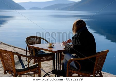 Dreamer Woman In A Terrace Of Restaurant With The Beach Background
