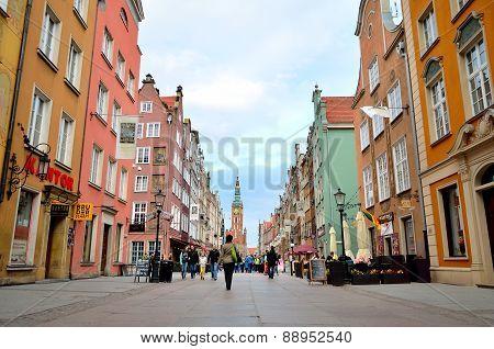 People walk Dluga street in Gdansk Poland.