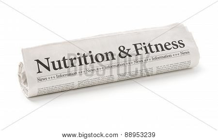 Rolled Newspaper With The Headline Nutrition And Fitness