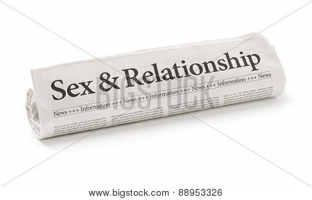 Rolled Newspaper With The Headline Sex And Relationship
