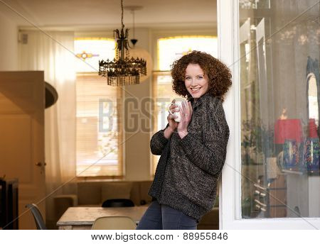Attractive Woman Relaxing With A Cup Of Coffee At Home
