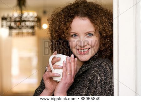 Smiling Older Woman Holding Cup Of Tea