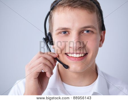 Customer support operator with a headset on white background