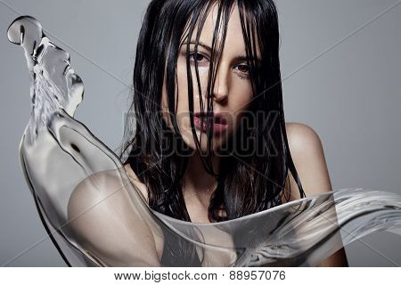 Woman With A Wet Hair And Water Splash